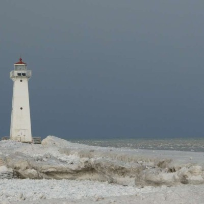 The working lighthouse at the end of the pier has an eerie beauty in wintertime.
